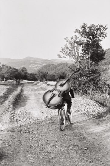 Bass player on the road Belgrade-Kraljevo, to play at a village festival near Rudnik, Serbia, Yugoslavia