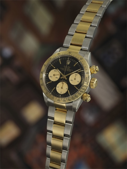 An extremely rare and possibly unique 18k gold and stainless steel chronograph wristwatch with presentation box and associated papers and images.
