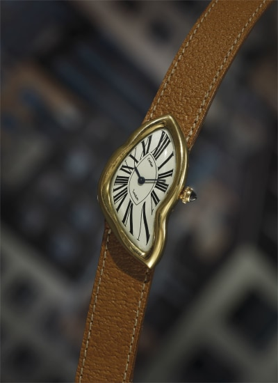 A large, extremely rare and very fine yellow gold asymmetrical wristwatch.