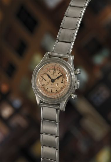 A rare and very attractive stainless steel flyback chronograph wristwatch with multi-scale salmon dial, accompanied by Extract from the Archives.