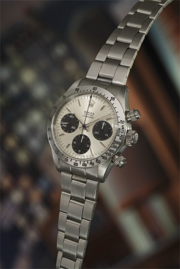 A rare and attractive stainless steel chronograph wristwatch with dial displaying 'Sigma' symbols, bracelet and punched guarantee.