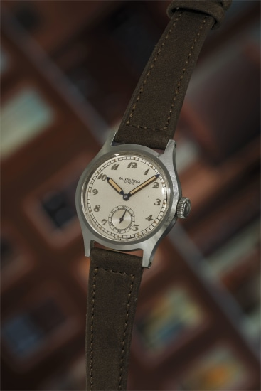 An extremely rare and highly attractive stainless steel wristwatch with silvered dial, Breguet numerals, luminous hour markers, and luminous hands.
