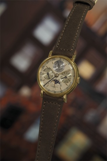An important and extremely rare yellow gold perpetual calendar wristwatch with leap year indication, moon phase aperture, and additional dial.
