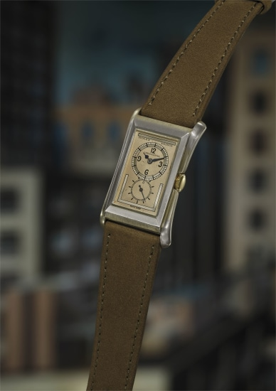 A rare and well-preserved silver rectangular wristwatch with flared lugs and two-tone dial with subsidiary seconds.