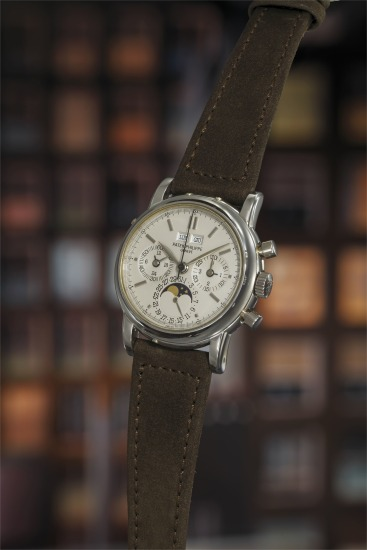 A very rare and attractive platinum perpetual calendar chronograph wristwatch with moon phase indication, original certificate, and presentation box.