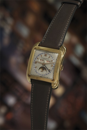 An extremely rare, important, and superb pink gold triple calendar wristwatch with moon phase, and two-tone silvered dial.
