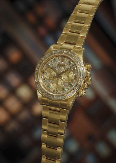 A very rare and attractive yellow gold chronograph wristwatch with diamond-set bezel and dial, emerald-set hour markers and bracelet, accompanied by presentation box, leather pouch, cloth, booklet and guarantee.