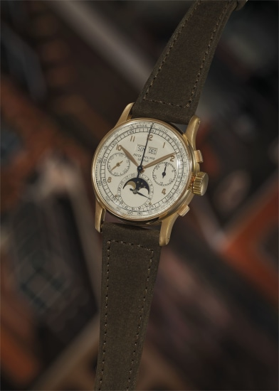 An extremely fine, rare and highly attractive pink gold perpetual calendar chronograph wristwatch with moon phase indication and tachymeter scale.