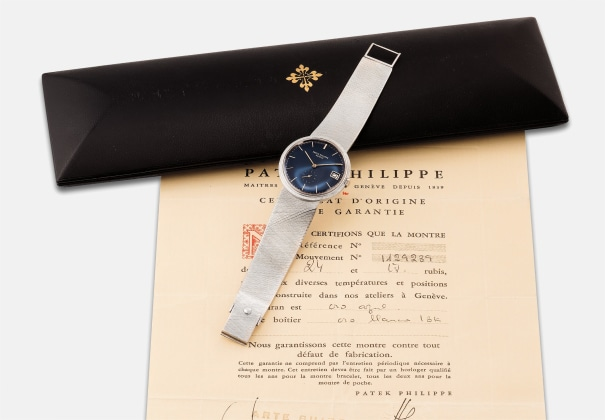 A rare and attractive white gold wristwatch with date, bracelet and original presentation box and certificate of origin