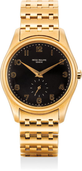 A highly attractive and possibly unique yellow gold wristwatch with Arabic numerals and bracelet