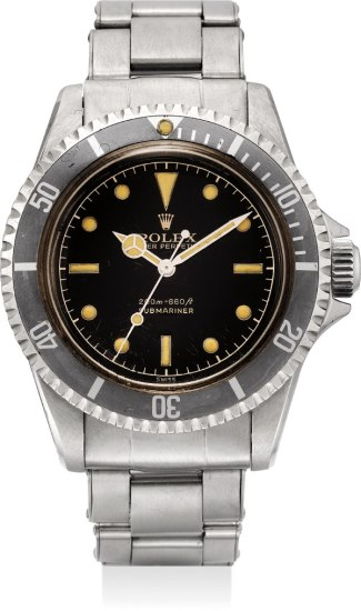 An extremely attractive and rare stainless steel wristwatch with black lacquer dial, pointed crown guards and bracelet