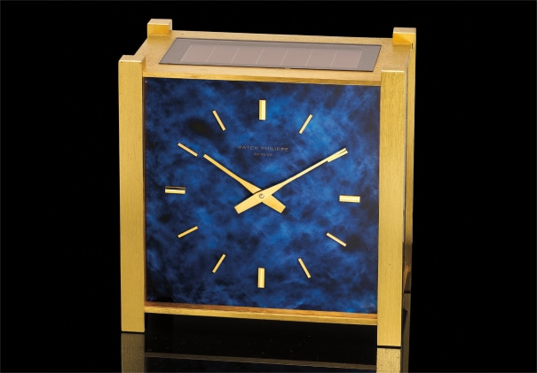 A fine gilt brass and faux blue marble square-shaped electronic quartz table clock