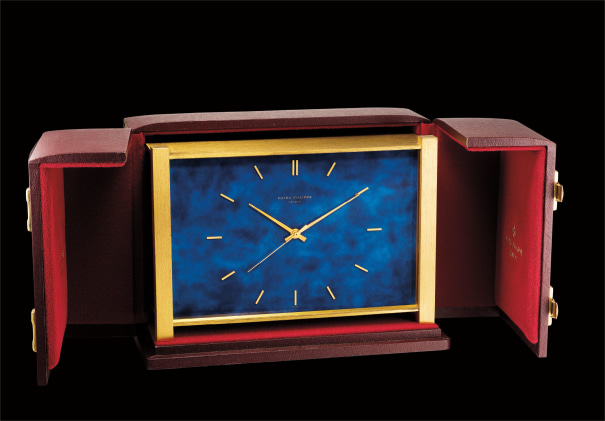 A fine gilt brass and faux blue marble rectangular-shaped electronic quartz table clock with center seconds