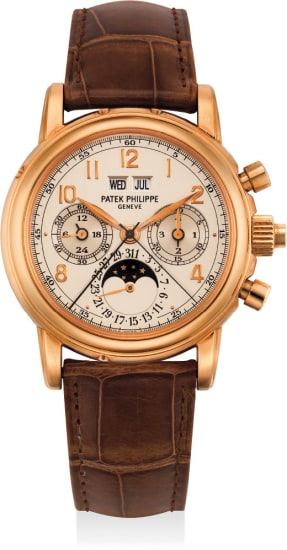 An extremely fine and very rare pink gold perpetual calendar split-second chronograph wristwatch with moon phases, leap year indication, 24 hours indication, second case back, Certificat and box