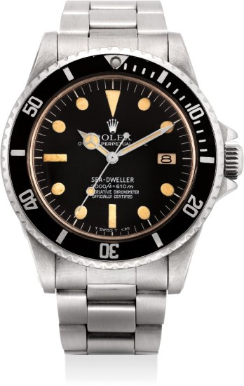 A fine and extremely rare stainless steel automatic diver's wristwatch with center seconds, date, rail dial and bracelet