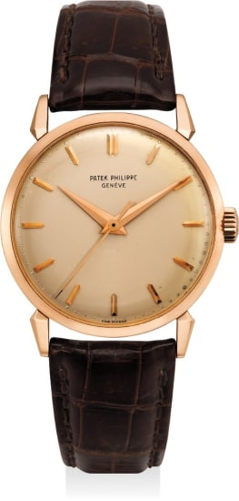 """A very fine, rare and attractive pink gold wristwatch with center seconds, """"spider"""" lugs and French import marks. Retailed by Jean Guillermin"""