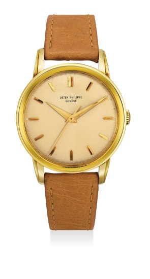 A very fine and rare yellow gold wristwatch with center seconds and box