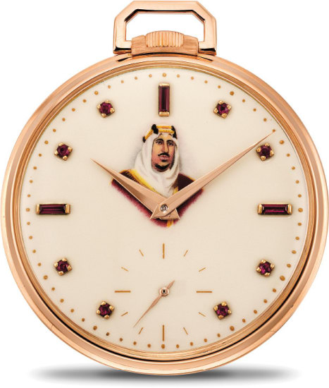 """A rare and very fine pink gold and ruby-set open face pocket watch with polychrome enamel portrait of Abdulaziz """"Ibn Saud"""""""