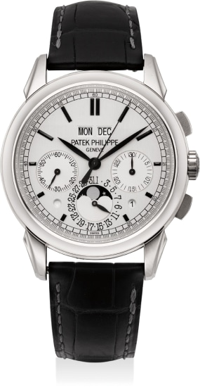 A rare and extremely fine white gold perpetual calendar chronograph wristwatch with moon phases, day/night indication, leap year cycle indication, additional solid case back, Certificat and box