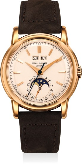 A highly important, very fine and extremely rare pink gold perpetual calendar wristwatch with center seconds, moon phases, screw back, Certificate, invoice and box