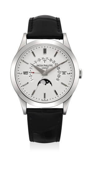 A highly attractive platinum perpetual calendar wristwatch with retrograde date, leap year indication and moonphase