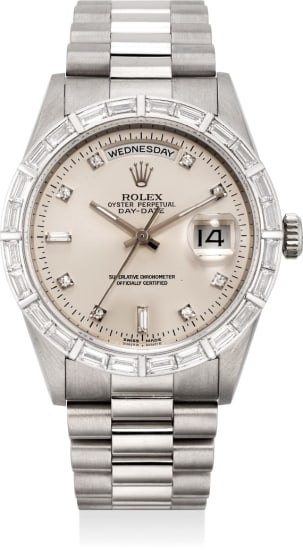 A very rare and fine white gold and diamond-set calendar wristwatch with center seconds and bracelet
