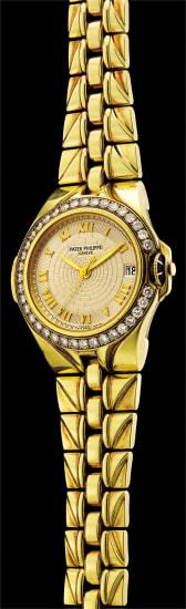 A rare and fine yellow gold and diamond-set wristwatch with date, center seconds, protective crown guard and bracelet