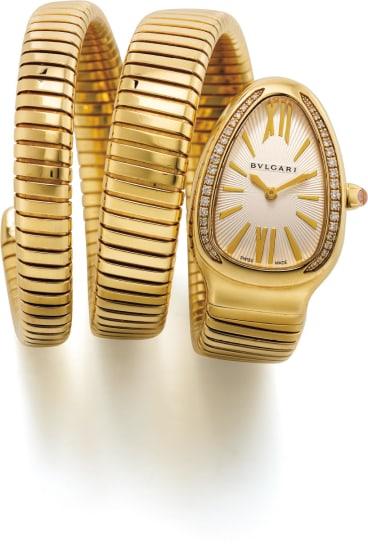 A lady's attractive and elegant yellow gold, diamond-set triple wrap bracelet watch