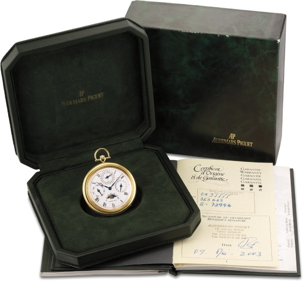A rare and attractive yellow gold open face perpetual calendar pocket watch with moonphase, leap year indication, original certificate of origin, presentation box and setting pin
