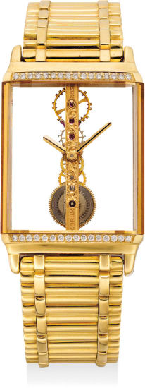 An attractive yellow gold and diamond-set skeletonized backwound wristwatch with bracelet
