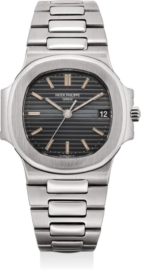 A rare and fine stainless steel wristwatch with date, center seconds, bracelet and original certificate of origin