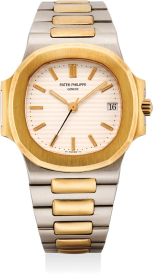 An attractive yellow gold and stainless steel wristwatch with center seconds and bracelet