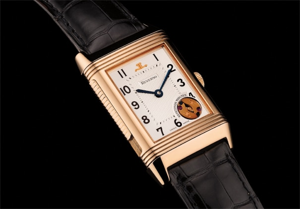 A very fine and very rare pink gold minute repeating rectangular-shaped reversible wristwatch with Garantie and box. Number 465 of a 500 pieces limited edition