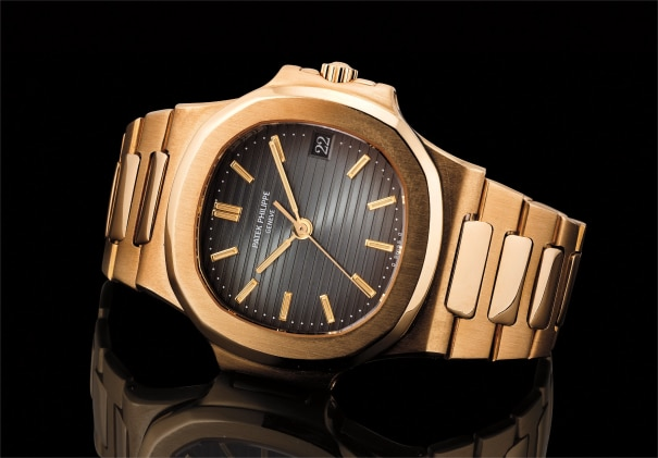 Ref. 3800 A fine and attractive yellow gold wristwatch with sweep centre seconds, date, bracelet and dark blue dial