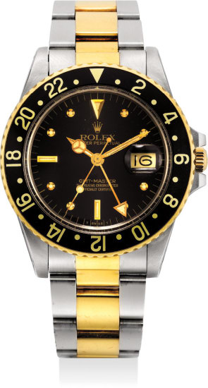 An attractive yellow gold and stainless steel dual time wristwatch with date, center seconds and original guarantee