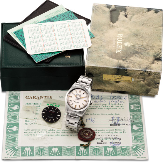 A fine, rare and extremely well preserved stainless steel amagnetic wristwatch with center seconds, additional black dial and hands, Garantie and box