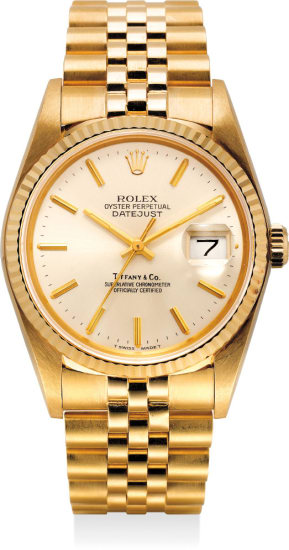 A fine and very rare yellow gold automatic wristwatch with center seconds, date and bracelet. Retailed by Tiffany & Co.