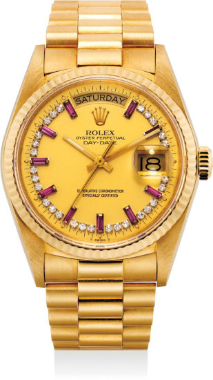 A very fine, rare and attractive yellow gold and diamond and ruby-set automatic wristwatch with center seconds, day, date, bracelet and Garantie
