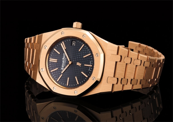 An exceptional pink gold ultra-thin wristwatch with date, bracelet and original presentation box and guarantee