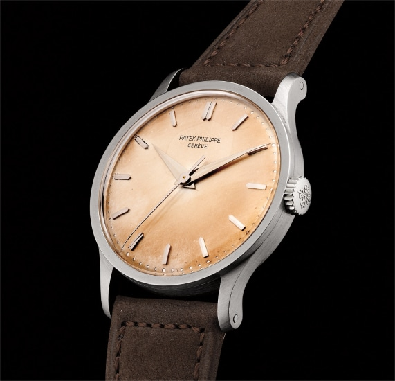 A very fine, rare and elegant white gold wristwatch with center seconds