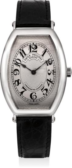 A fine platinum tonneau-shaped wristwatch