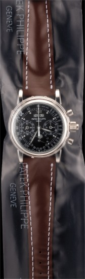A possibly unique, very important and extremely attractive platinum perpetual calendar split-second chronograph wristwatch with phases of the moon, leap year indication, 24 hours indication, special black luminous monogrammed dial, Certificate and box