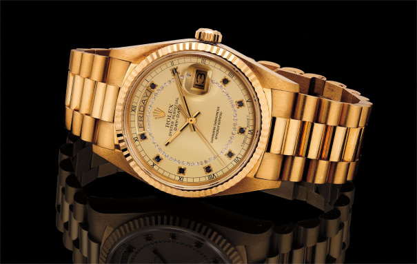 A fine, rare and very attractive yellow gold and diamond and sapphire-set automatic wriswtatch with center seconds, day, date and bracelet