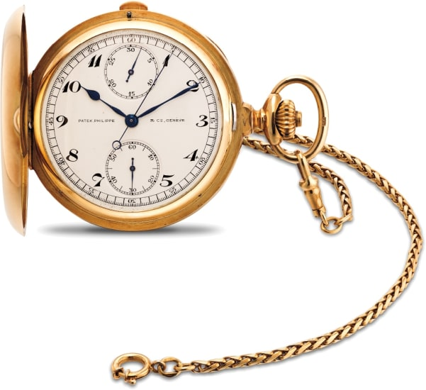 A fine and attractive yellow gold hunter case chronograph pocket watch with Breguet numerals and 18K yellow gold watch chain