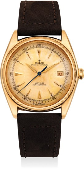 A fine and rare yellow gold wristwatch with date and center seconds
