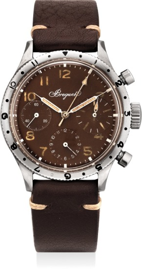A rare and highly attractive stainless steel flyback chronograph with tropical dial