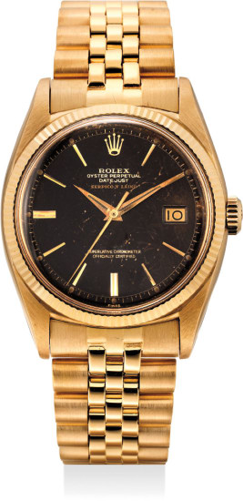 A fine and attractive pink gold wristwatch with tropical black lacquer dial and center seconds, retailed by Serpico y Laino