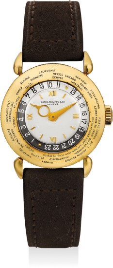 A very fine and rare yellow gold world time wristwatch