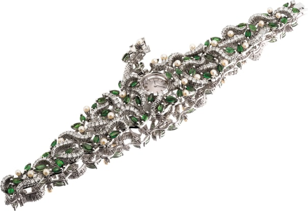 A lady's exquisite white gold, diamond, tourmaline and pearl-set bracelet watch with concealed dial