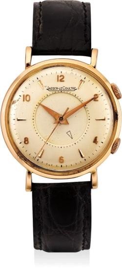 A fine and rare pink gold alarm wristwatch
